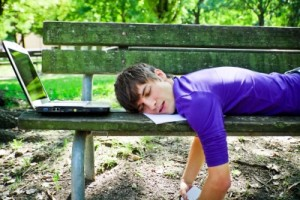 working man sleeping on bench