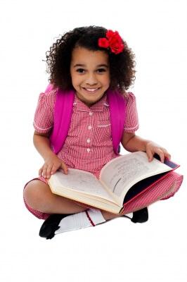 girl reading textbook